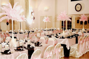 Pink and Chocolate Sweet 16 Birthday Party, Pink Feather Centerpieces, Satin Table Linens and Satin Chair Covers. SBD Events