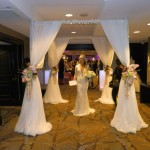 White 4 Post Canopy created by SBD Event Designs, Sheer Fabric with Flowers