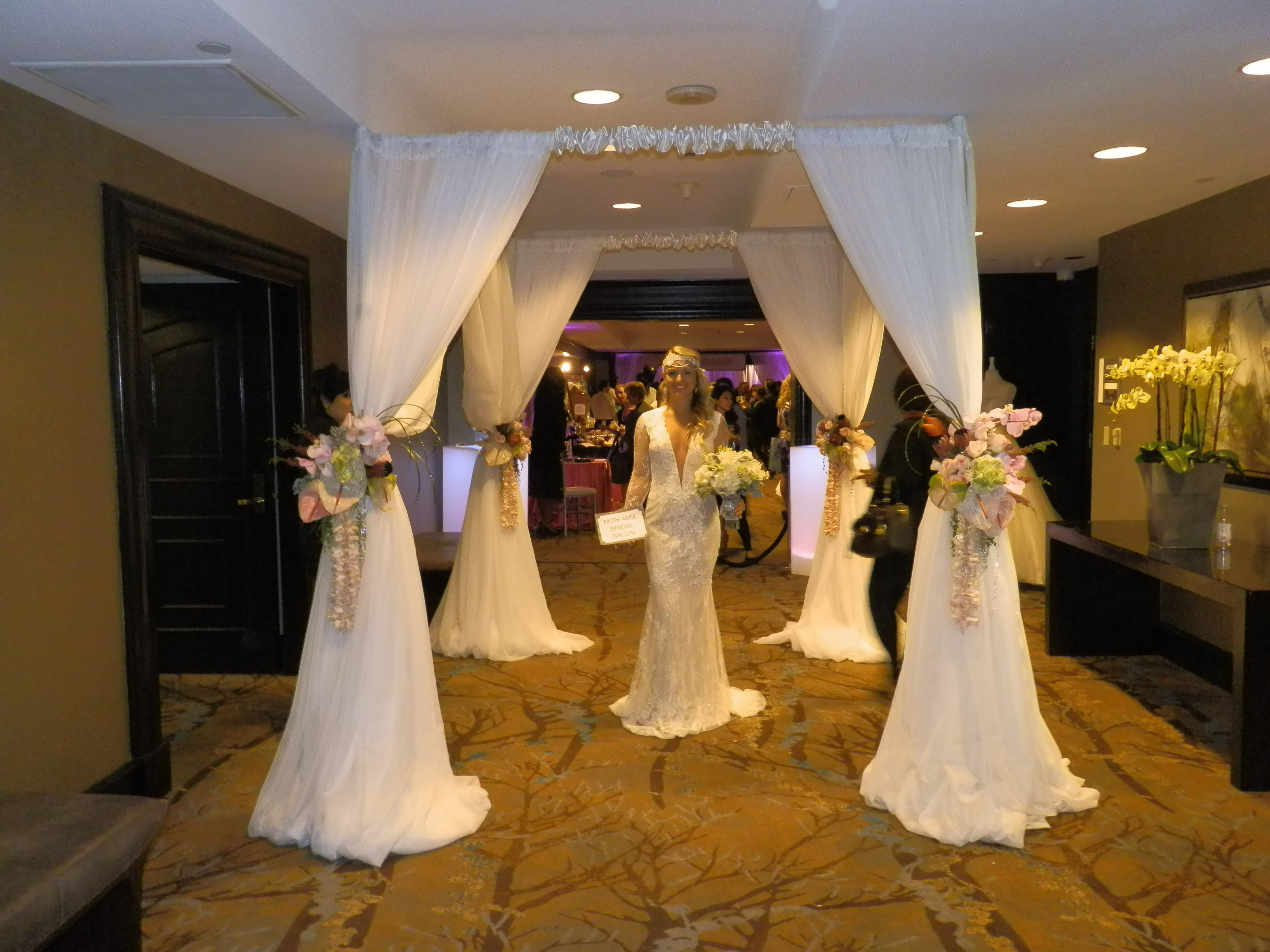 White 4 Post Canopy Created By SBD Event Designs Sheer Fabric With Flowers