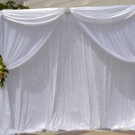 Platinum Backdrop with Crystal Curtains and Flowers by SBD Events and SBD Event Designs